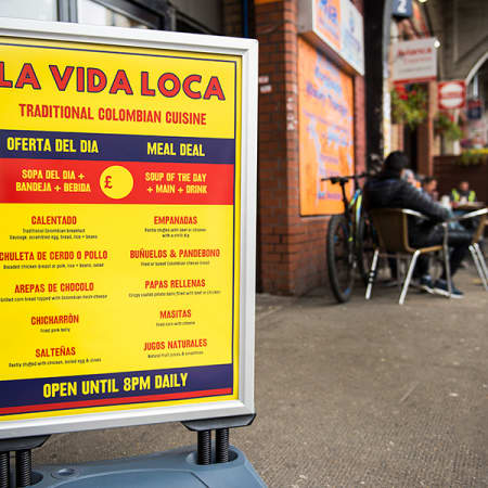 New pavement sign with menu and logo designed by Lauren Vaughan for La Vida Loca Colombian restaurant located in the arches at Elephant Rd.