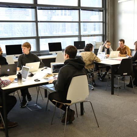 Postgraduate students working within the Graduate School Space in London College of Communication.