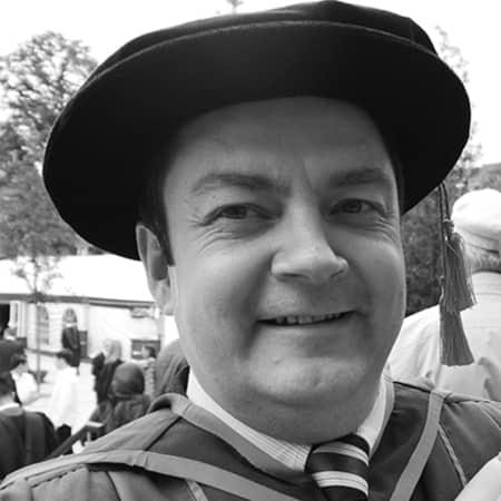 Black and white image of Steven MCDermott at graduation.