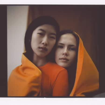 Two models in orange shawls by Crystin Moritz