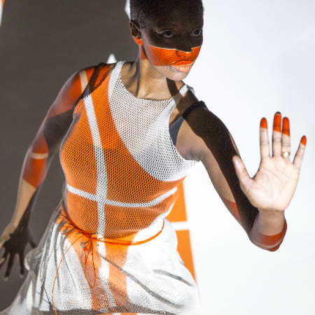 Model with orange shadows