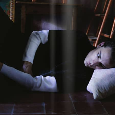 The Flag magazine editorial shoot image of male model lying down.