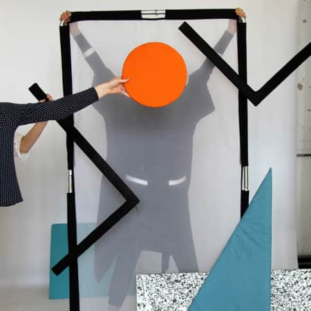 Girl behind a screen with an orange circle in replacement of her face