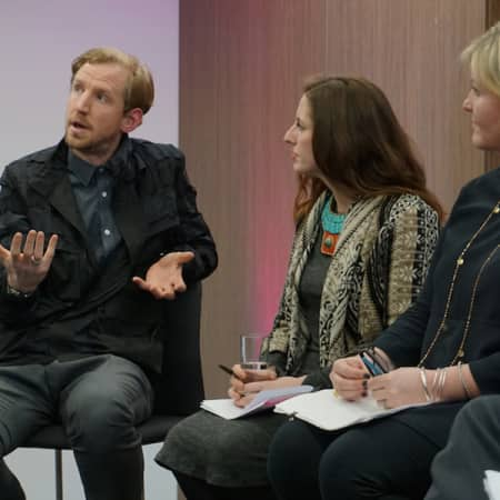 Three people in discussion, including fashion designer Christopher Raeburn,