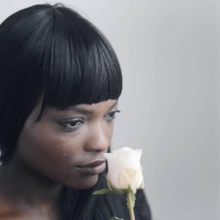 Model holding rose