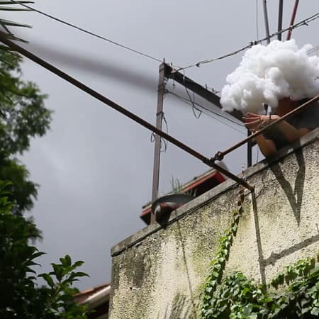 Person on roof in cloud like headpiece