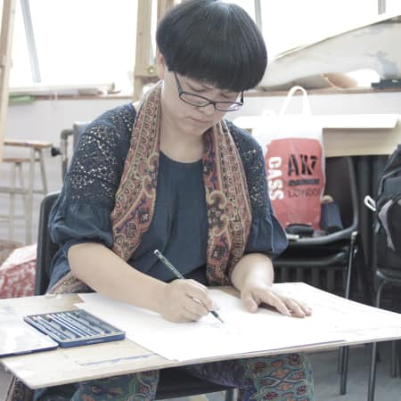 Image of student in fashion drawing short course