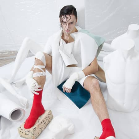 Model in white material and red socks with sponge shoes.