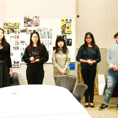 Students presenting at Amnesty Internation