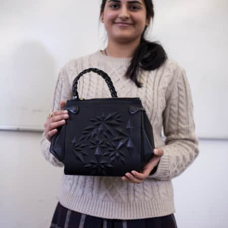LCF student Kamakshi Palli with her bag designed for Inditex
