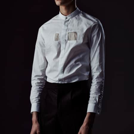 Male model in collarless shirt.