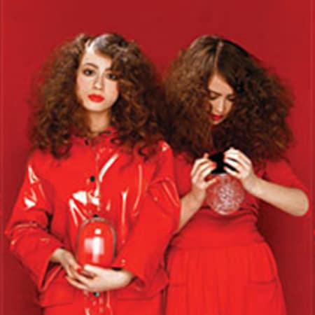 Red image, with two models holding cosmetics bottles