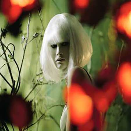 Hazy image of a model in a white bob wig