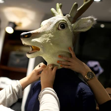 A deer head on a mannequin.