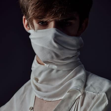 Close-up of male model wearing shirt and face covering
