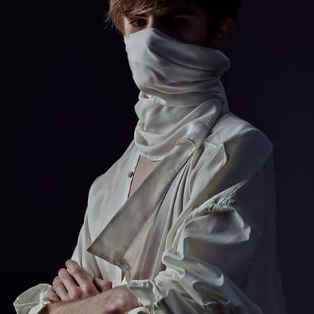 Male model wearing shirt with face covering