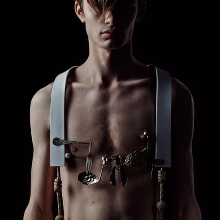 Male model topless, wearing body jewllery