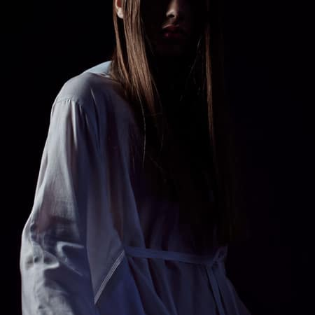 Model wearing shirt against dark backdrop