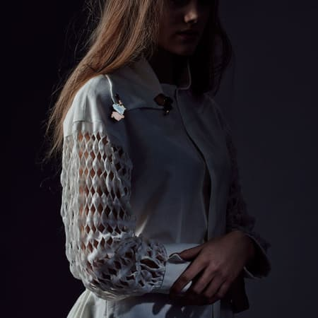 Model in lattice jacket-shirt with badges