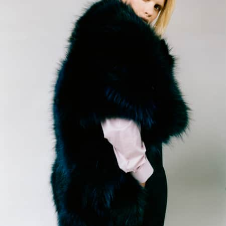 model wearing black fur jacket