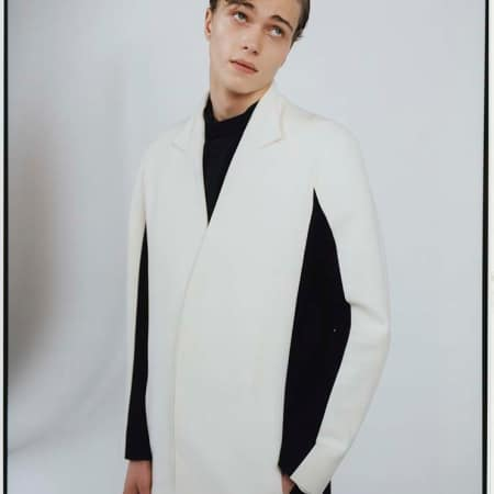 male model wears black and white jacket