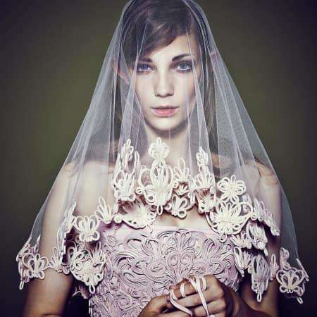 A model in a bridal veil