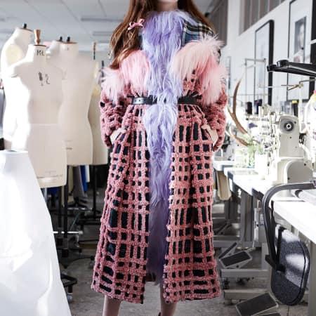 A model in a furry check coat by Barbra Kolasinski