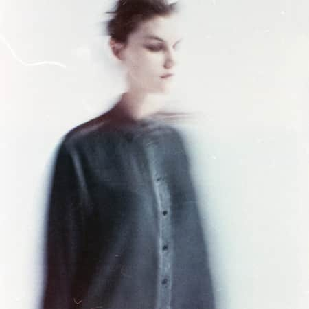 Blurred image of a model in black.