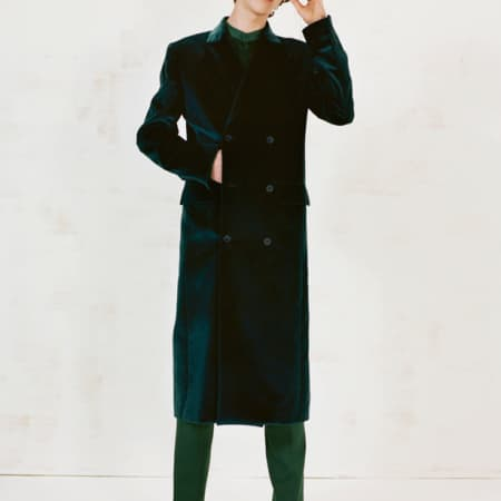Male model in long coat and sci fi glasses. MA16