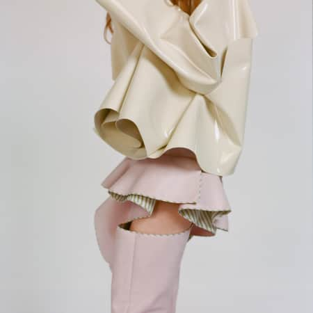 Cream and pink boots and jacket with frills by Siyang Meng