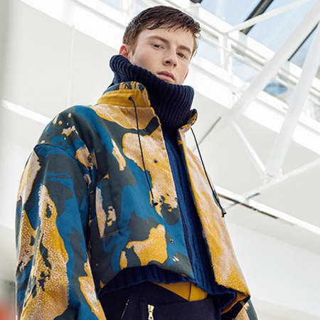 Model in blue and yellow coat.