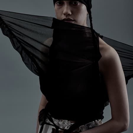Female model in abstract black outfit