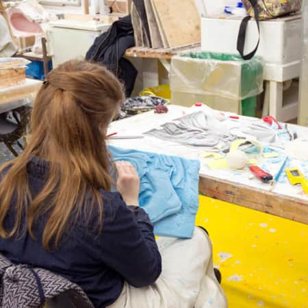 Student working on a foam prop during a prop making short course at Wimbledon