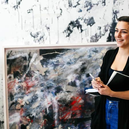 Image of Marie-Aimee Fattouche standing in front of a canvass
