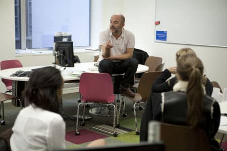 Image of tutor and students in Fashion journalism short course