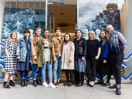 Students, staff and Whistles team in front of one of the windows.