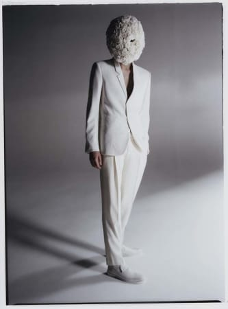 man in white suit and white headpiece