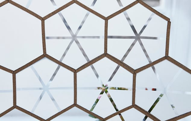 Image shows hexagon shapes on glass