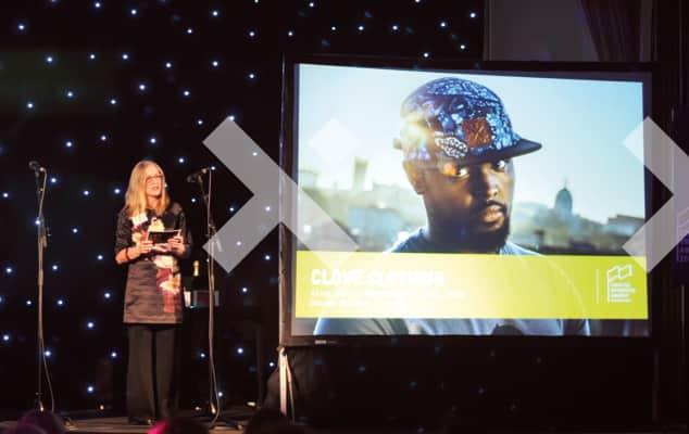Professor Susan Orr presenting award on stage