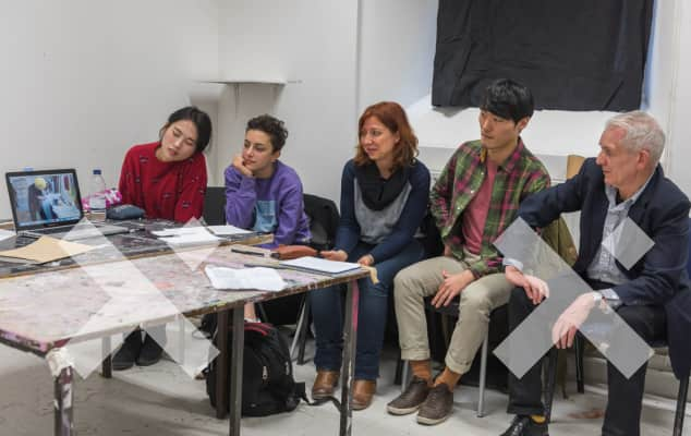 Staff and students in studio crit