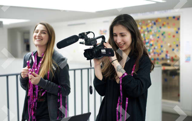 Students filming with digital camera