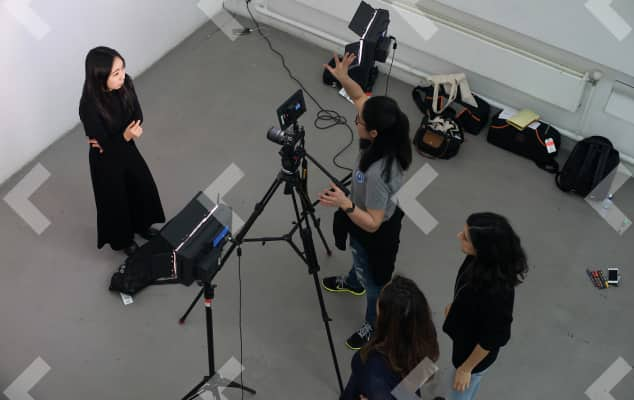 Birds eye view of students filming an interview