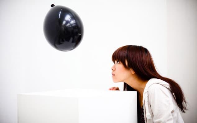 Girl looking at work by Jeff Chun-Hee Luu
