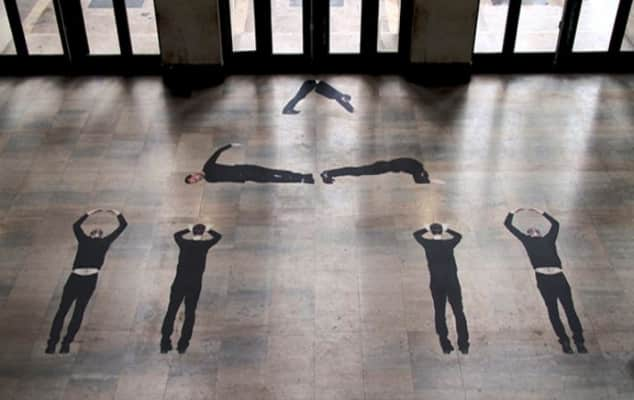 Images of a man in black which are stuck to a tiled floor