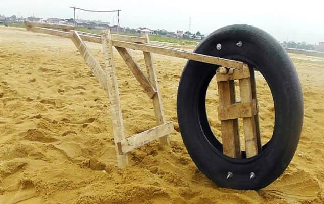 Image of an sculpture made from a tyre and wood