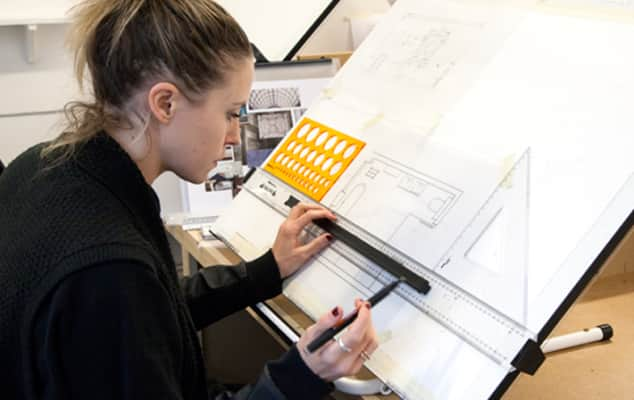 Student doing a technical drawing during an interior design course.