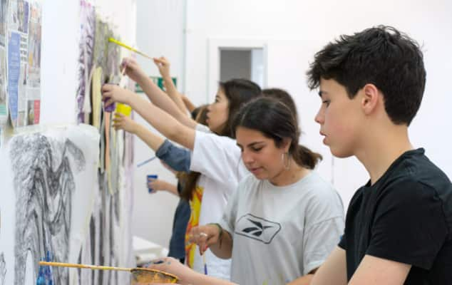 Student working on painting during international summer school