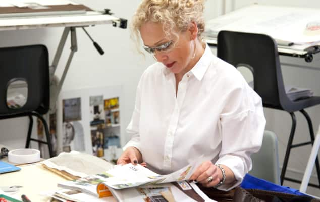 Student perusing and interior design magazine for ideas during an Interior Decoration course.