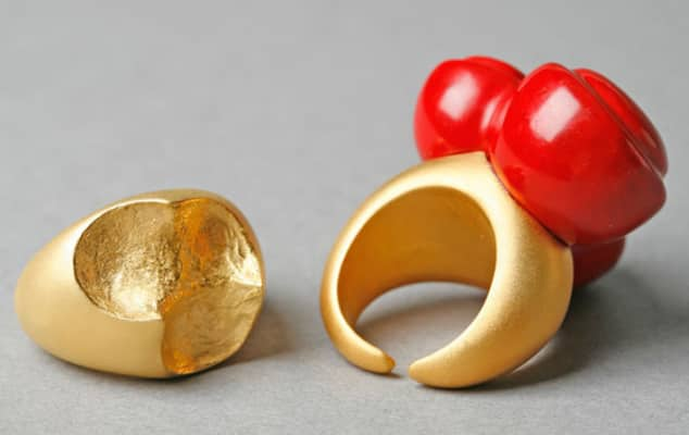 Gold and bright red jewellery pieces.