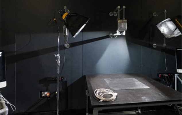 Image of a table with lights shining onto it in an animation studio